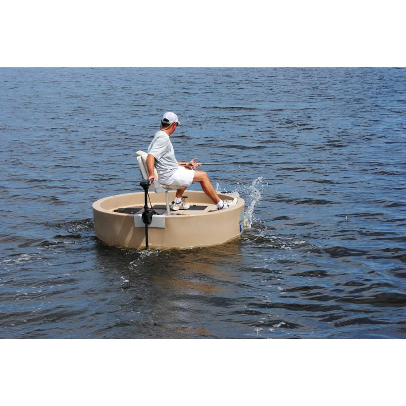 A fisherman driving a round boat with an electric trolling motor.
