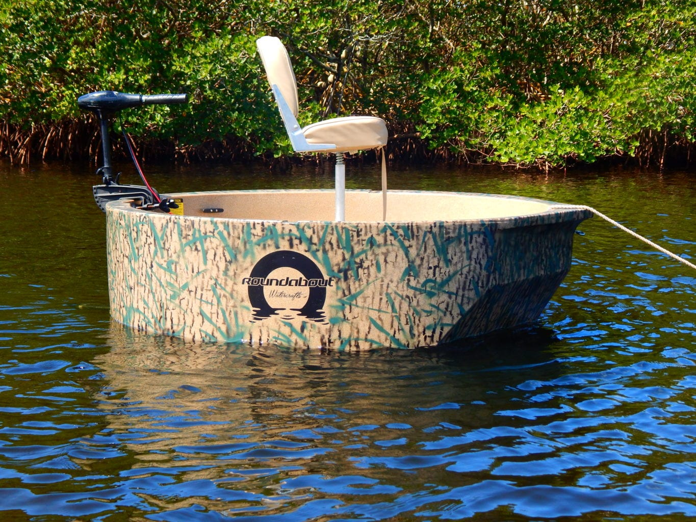 The woodsman hunting boat sitting on the sand along the shoreline