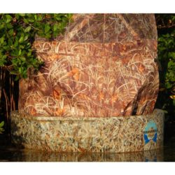 The woodsman hunting boat and ameristep round boat blind sitting deep in the mangroves, closer crop