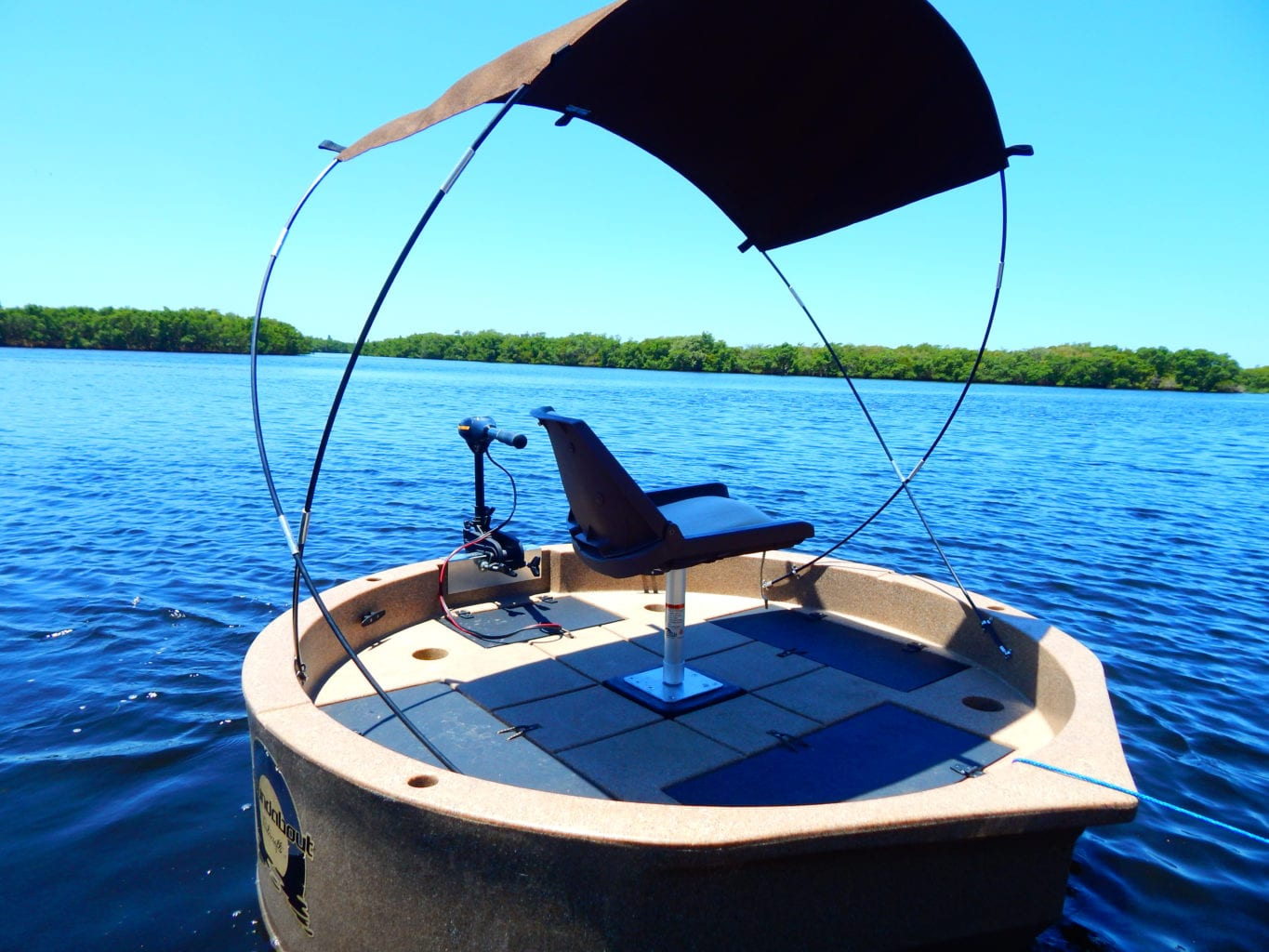 This shows the sunshade installed on a tan colored round boat