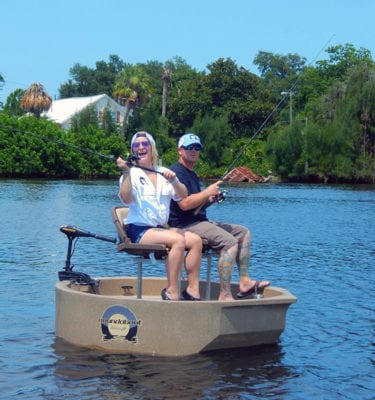 friends fishing from a round boat with a two seat option