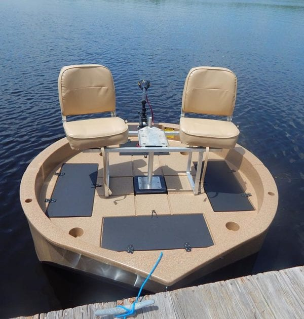 This is a wide shot of the two seat conversion kit on the round boat while tied at the dock.