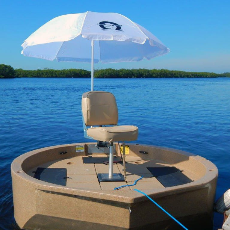 A Roundabout Watercraft docked with the sunshade attached